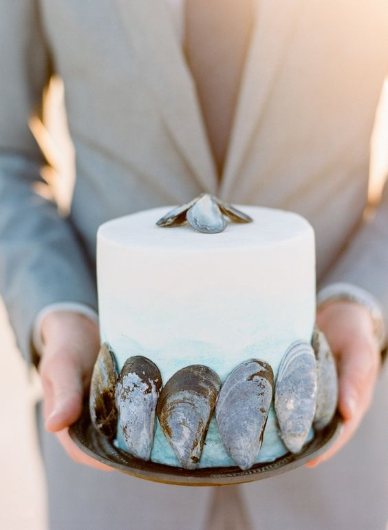 ombre blue wedding cake with shell decor