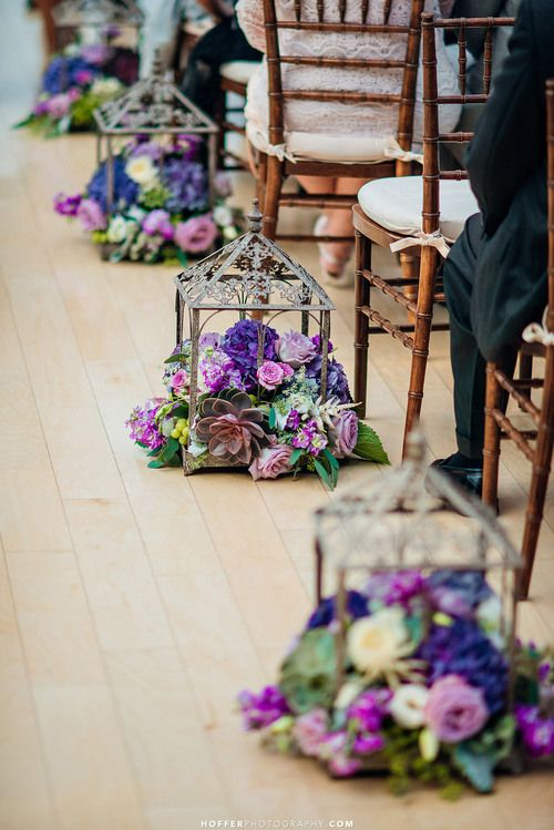 terrariums filled with super bold florals for lining up the aisle