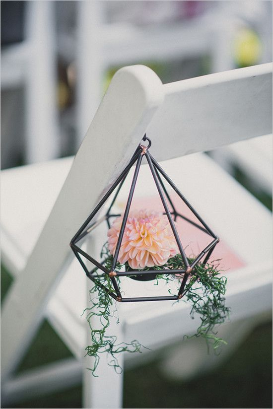 hang terrariums to the aisle chairs for creative decor