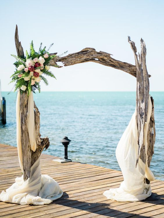 a spectacular driftwood wedding arch for a waterfront ceremony