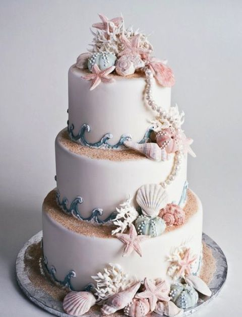gorgeous seashore cake that looks very natural, with sand, shells and star fish