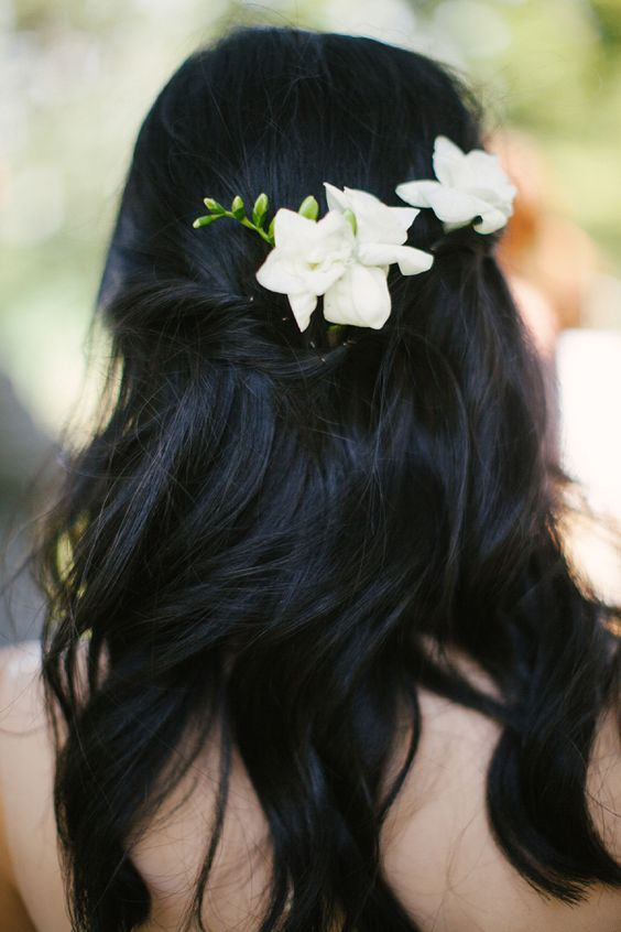 half updo with simple white flowers for a beach bride