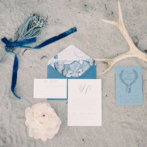 shades of blue and traditional sea prints are perfect for seaside wedding stationary