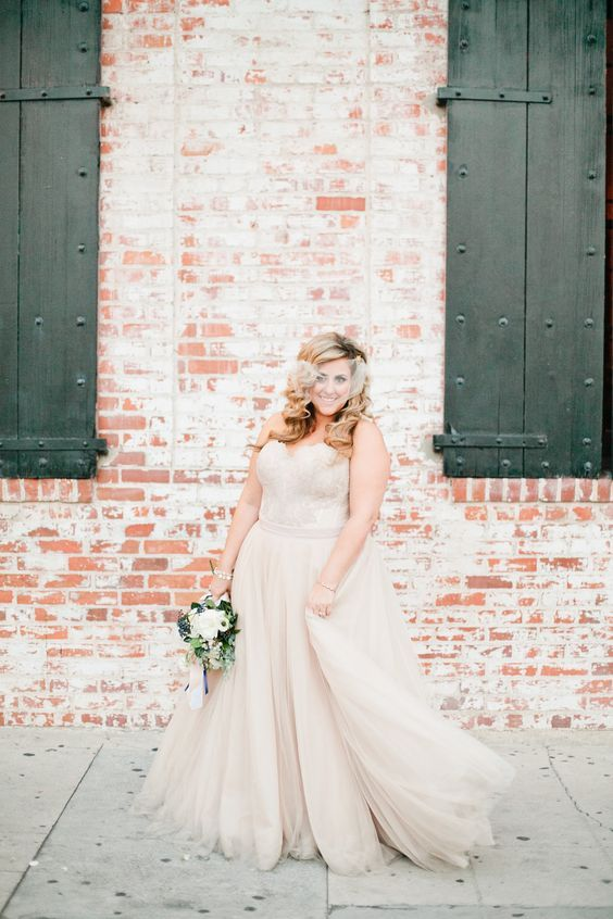 strapless blush wedding gown and a matching veil