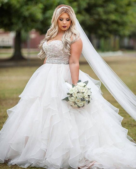 strapless empire waist wedding dress with a jeweled bodice and a ruffled skirt