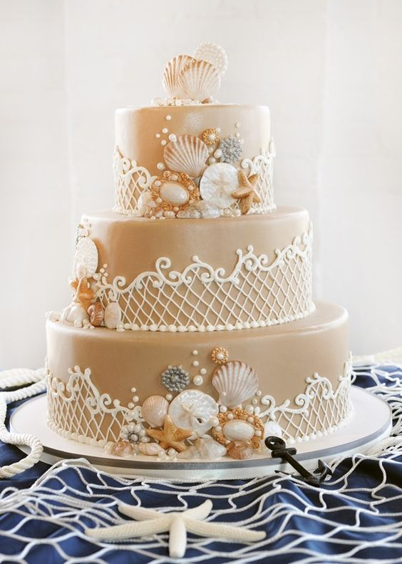 sand colored wedding cake with shells and star fish