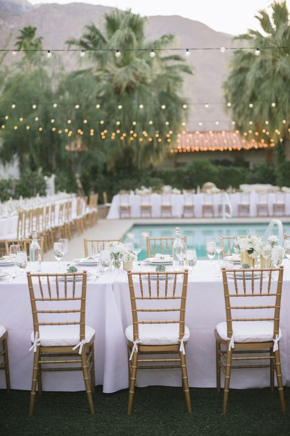 simple neutral wedding reception by the pool
