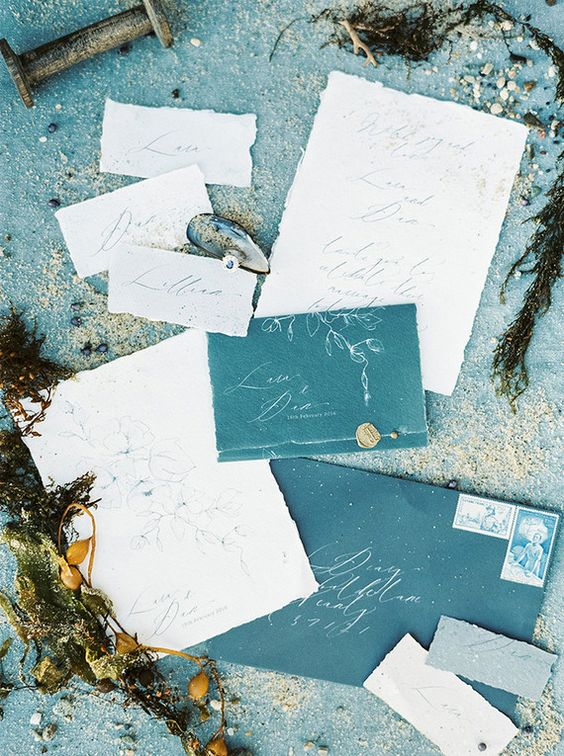teal and blue calligraphy wedding stationary looks cool