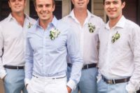 35 white pants, a light blue shirt and a floral boutonniere