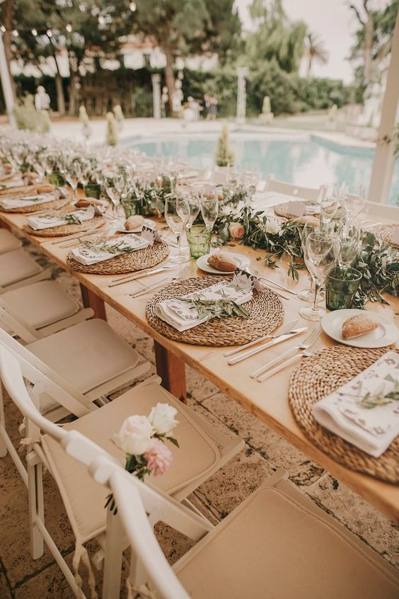 Toscana styled wedding reception with olive branches and wicker place settings