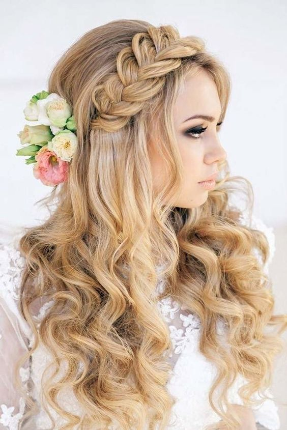 gorgeous braided half updo with curly locks and some fresh blooms