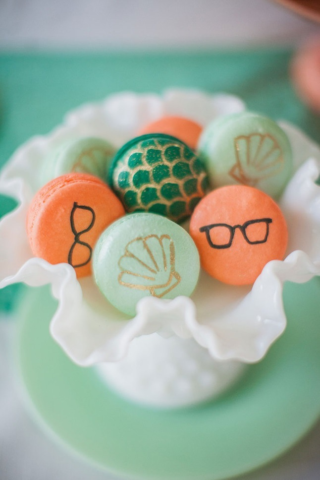 sea inspired macarons displayed in a large shell