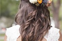 37 braided half updo with fresh blooms and thistle