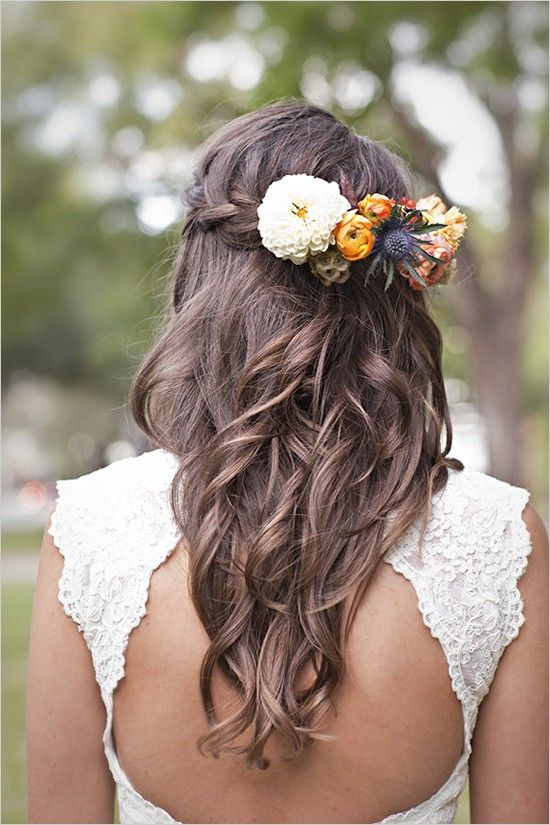 braided half updo with fresh blooms and thistle