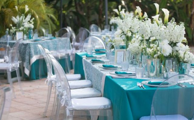 turquoise and white poolside reception with flowers