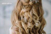 39 half up half down curly hairstyle with just some baby's breath