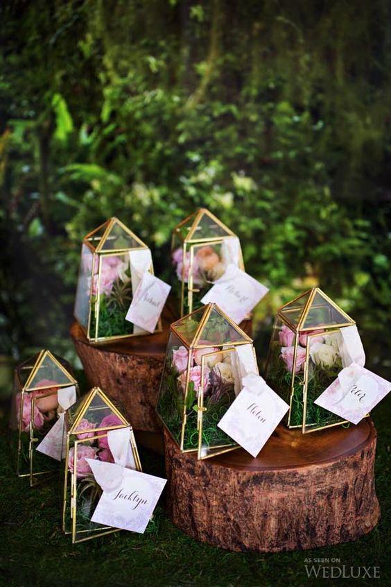 terrarium wedding favors filled flowers for a secret garden wedding