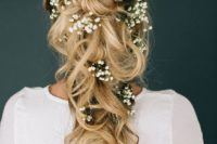 40 loose braided half updo with baby's breath