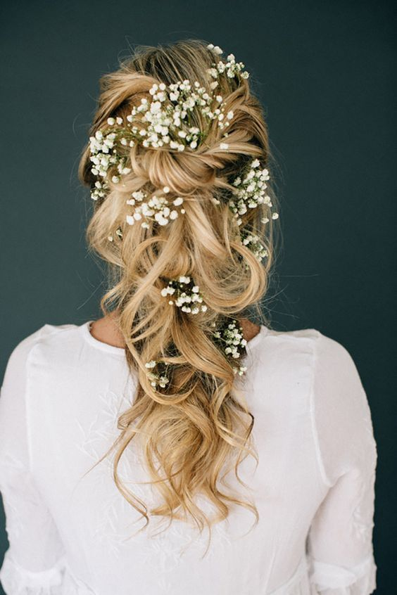 loose braided half updo with baby's breath