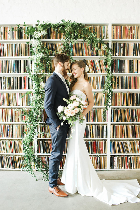 This romantic wedding shoot took place in Brooklyn Art library, and sketches from artists all over the world became a perfect backdrop
