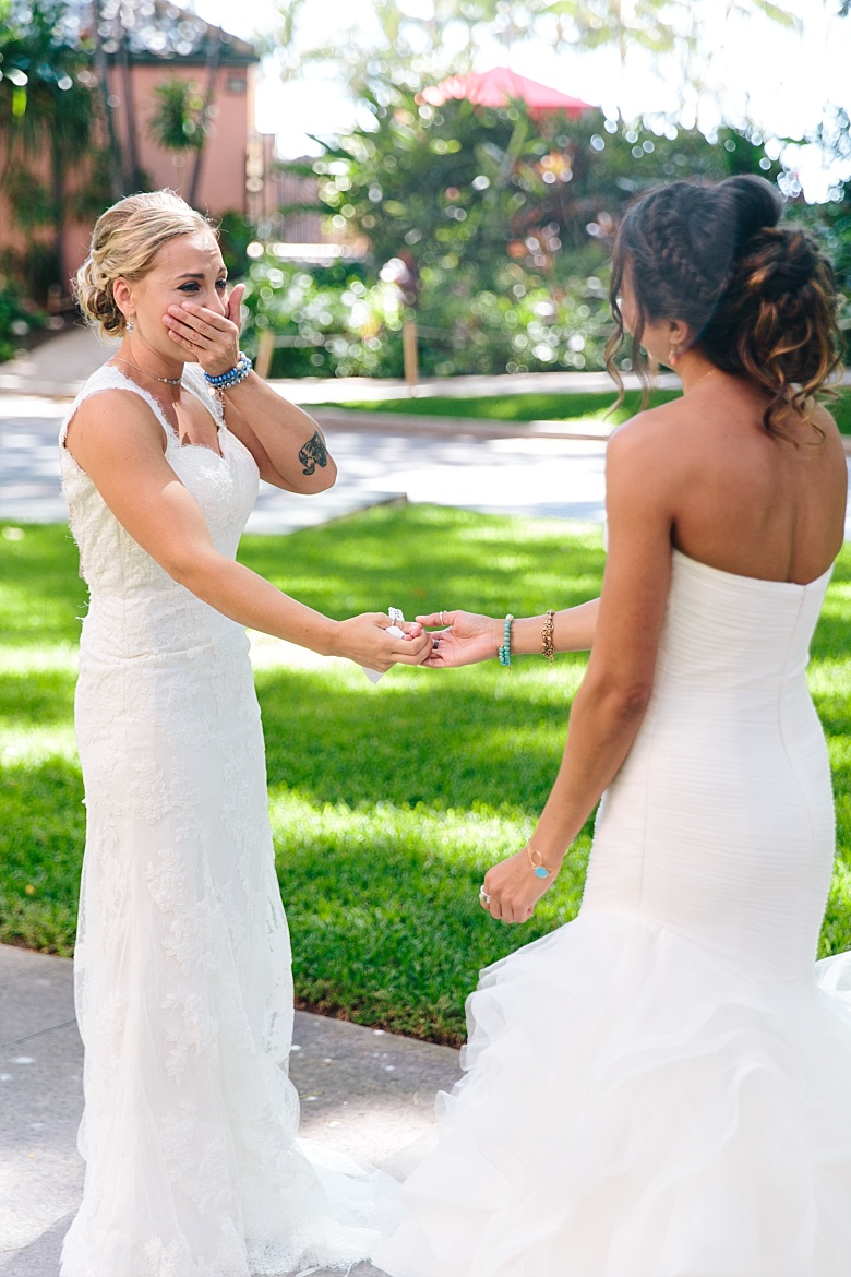 One bride was rocking a thick strap lace wedding gown, various boho accessories and showed off her tattoos