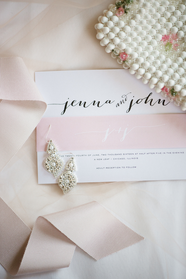 The bride was wearing a sash to highlight her waist and pearl earrings