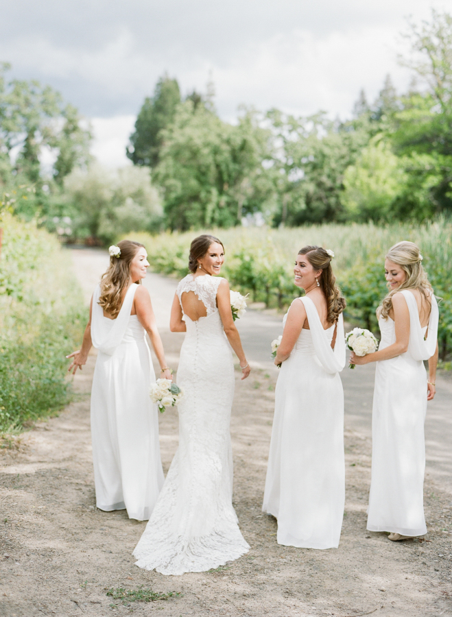 The bridesmaids were wearing white and off-whites, the bride was rocking a keyhole back wedding dress of lace