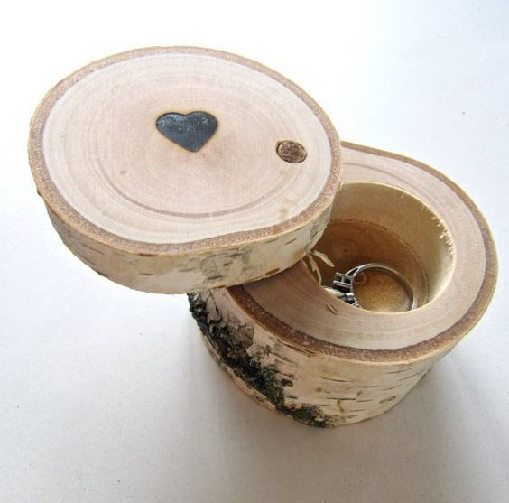 a birch log ring box with a cut out inside