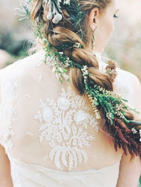 a braid with greenery and small flowers is a great idea for a woodland bride