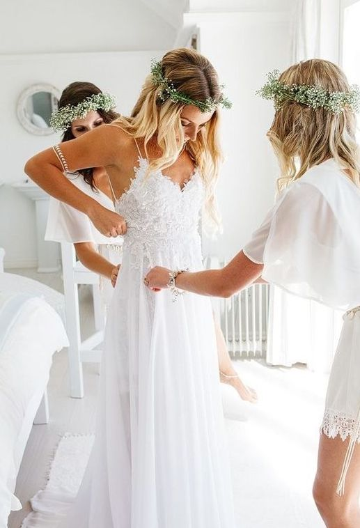 a spaghetti strap wedding dress with a lace bodice and a V-neck