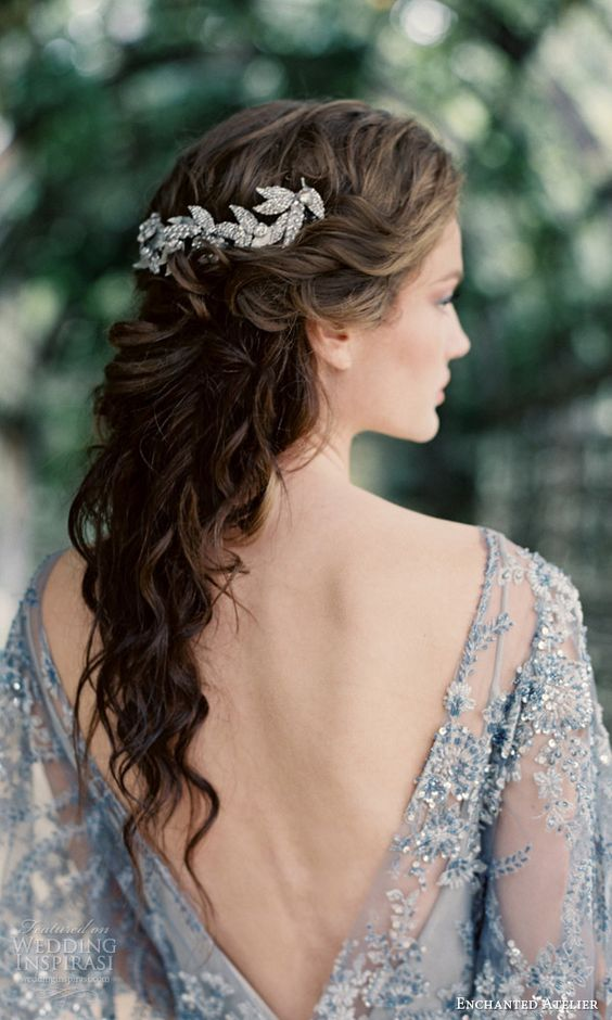 curly bridal half updo with a sparkling leaf hair vine