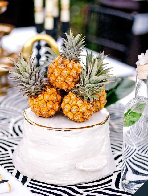 one tier wedding cake topped with little pineapples
