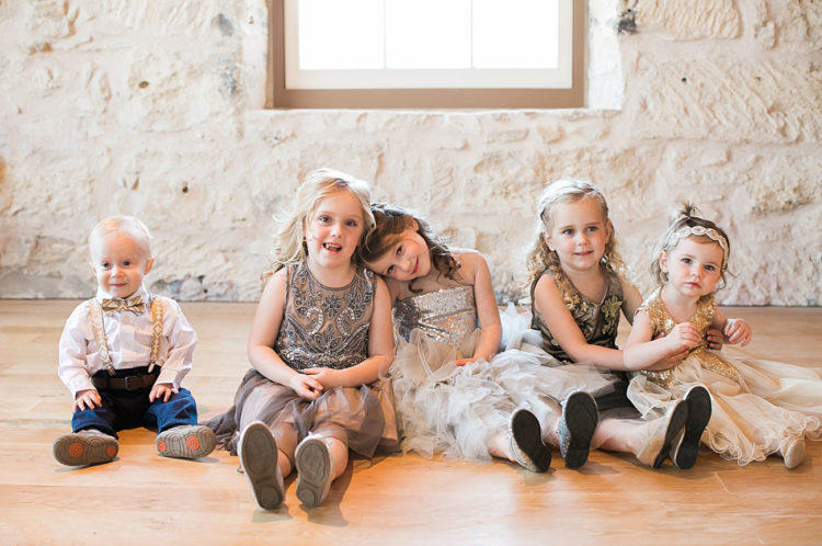 Sparkling flower girl dresses were crafted especially for these nuptials