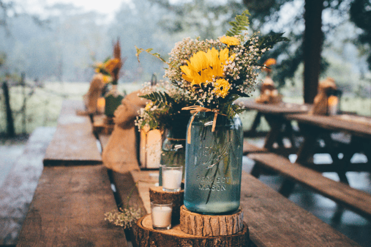 The wedding decor was done with boho and rustic touches, with 60s and 70s music