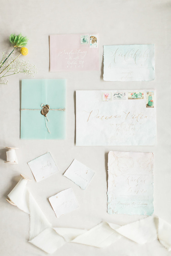 The wedding stationary was done in soft pastels