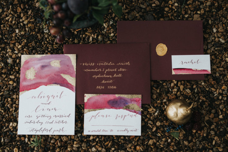 The wedding stationary was moody burgundy with gold touches