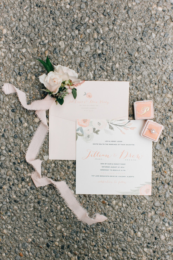 There were sweet blush touches added to the wedding decor but the couple didn't have an exact theme per se