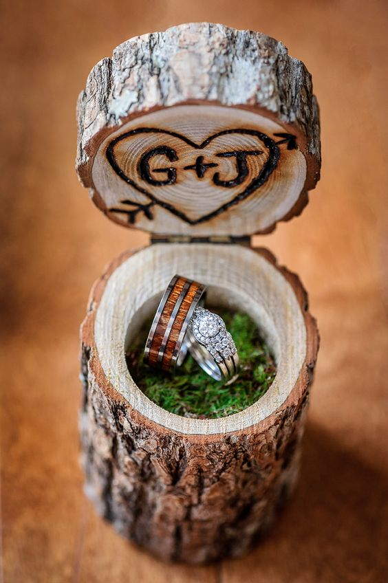 a real wooden log box with moss and burnt monograms