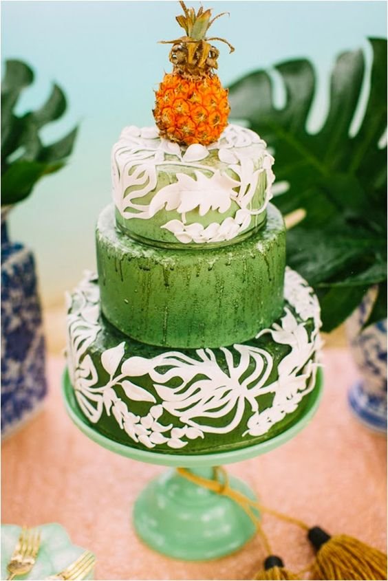 bold green wedding cake with white patterns and a pineapple