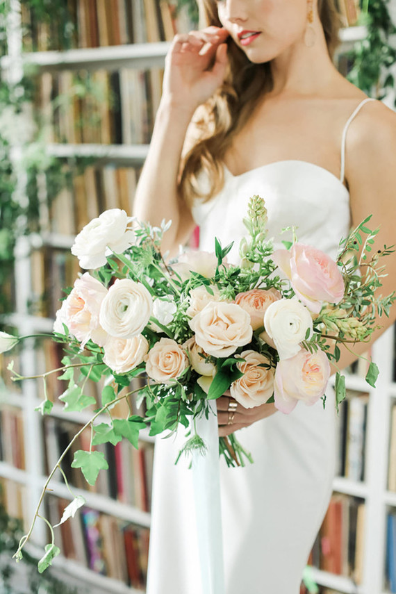 The bridal bouquet was done in soft peachy and blush shades with greenery