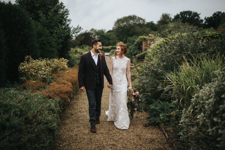 The bride was rocking a relaxed Claire Pettibone gown, an updo and a boho headpiece