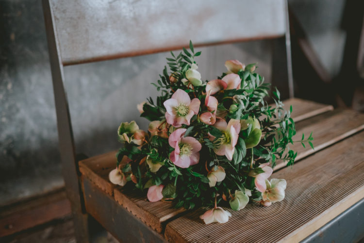 The bride was rocking a simple greenery and pink bloom bouquet