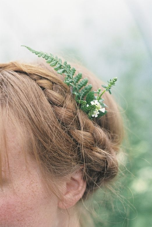 a green leaf and a couple of flowers in your hair