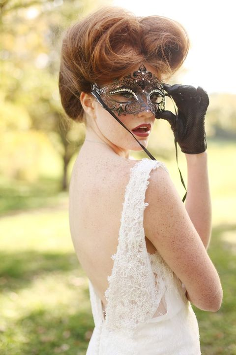 a refined black mask with beads and black gloves as accents