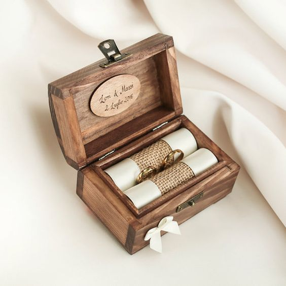 a rustic wooden box with burlap ring holders