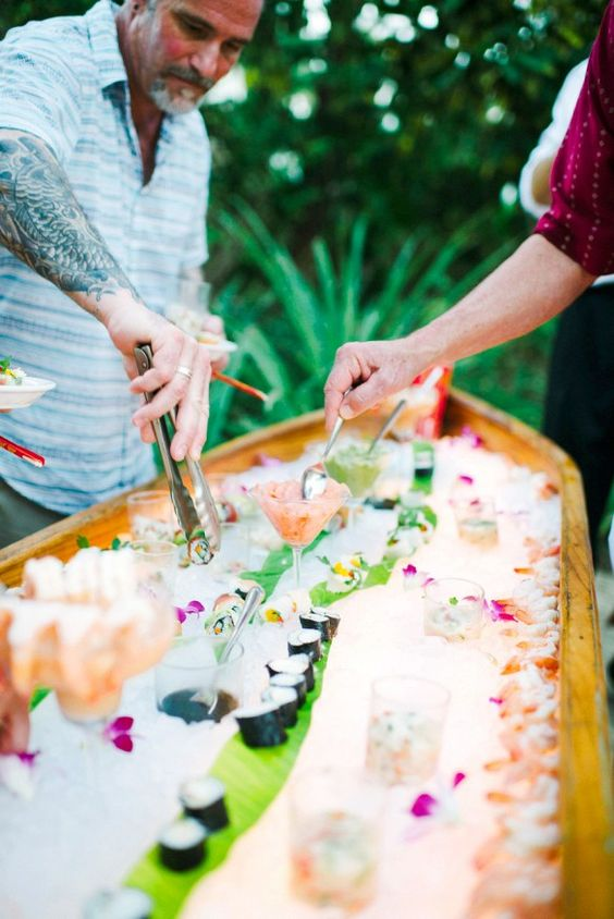 a sushi bar in a canoe looks very fresh and inspiring, just fill it with ice