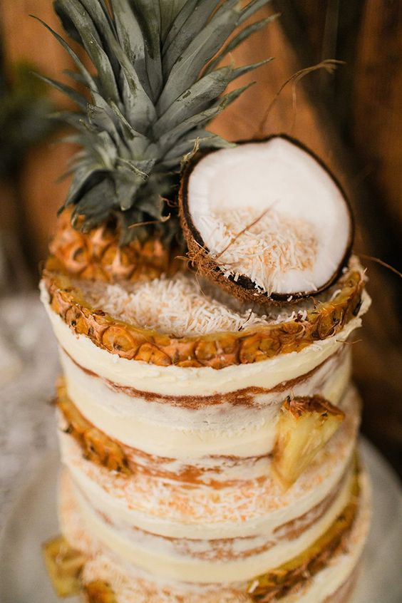 pineapple dirty icing wedding cake topped with a coconut