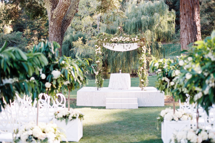 The wedidng aisle and chuppah looked very elegant and chic