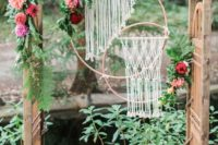 05 a wooden arch with leaves, flowers and macrame hangings