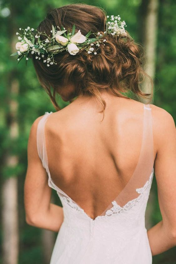an ivory flower, baby's breath and greenery bridal crown